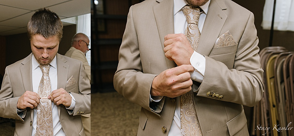 Groom getting dressed at church