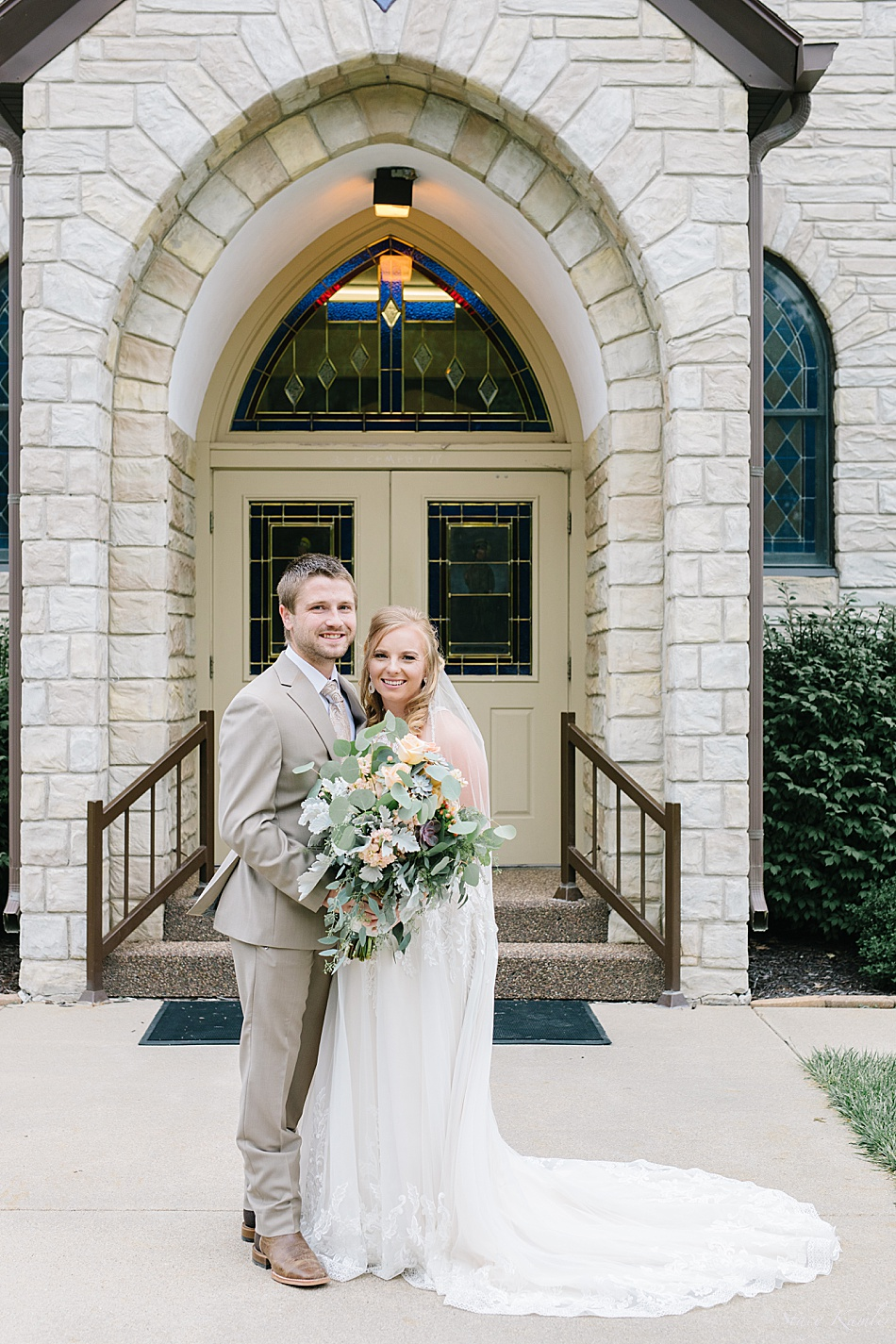 Bride and Groom in front of Saint Wenceslaus Catholic Church in Wilbur, NE