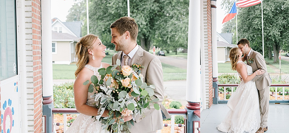 Bride wearing a lace dress and groom wearing a tan suit for portraits