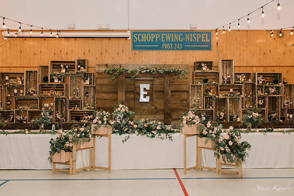 Head table with wooden boxes and rustic chic wedding decor