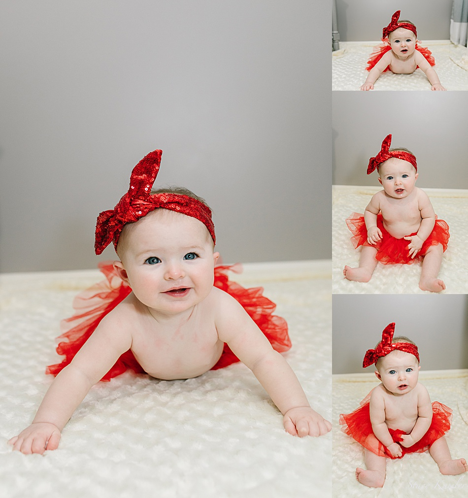 Baby in red tutu at 6 months