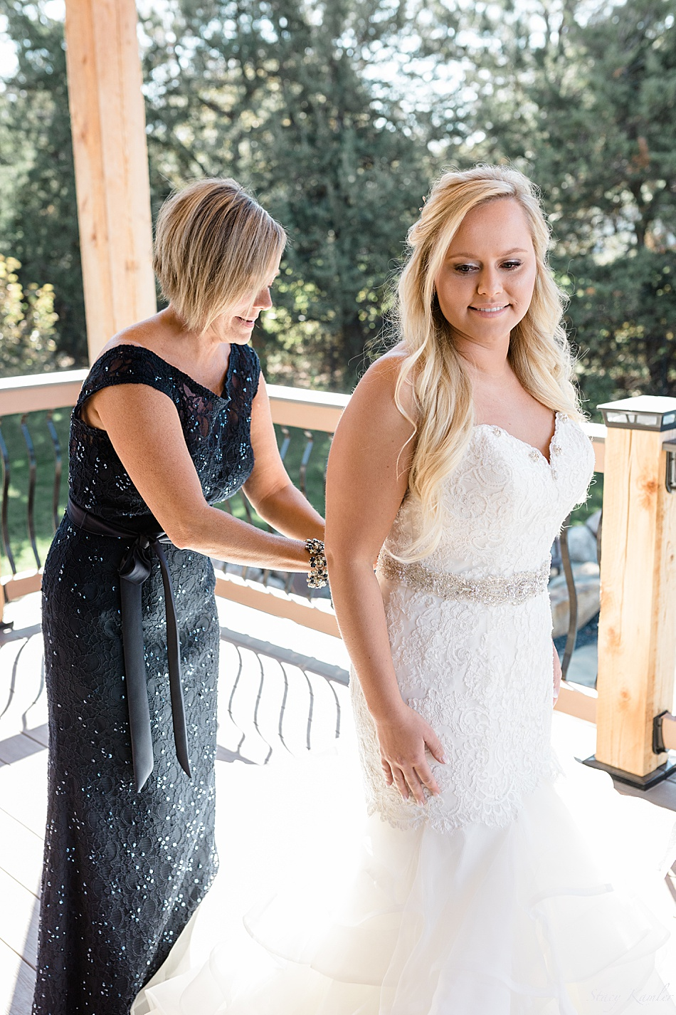 Bride putting on Mori Lee wedding dress