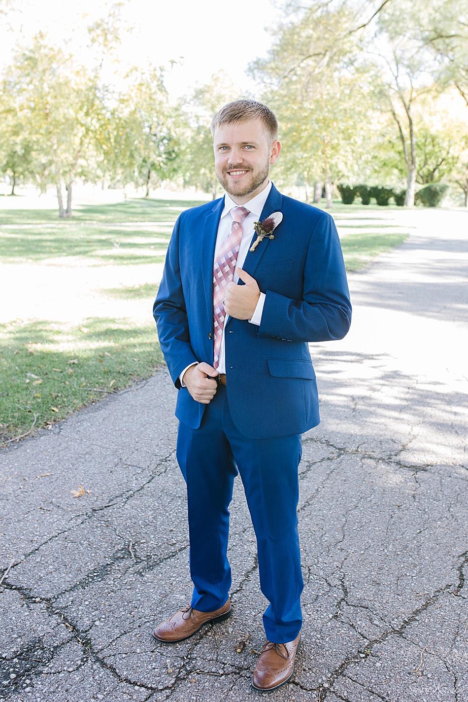 Groom in navy blue suit