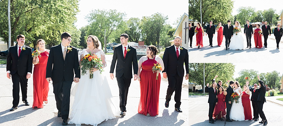 Bridal Party in red dresses and black suits