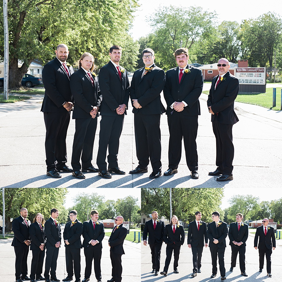Groomsmen in black suit and red tie