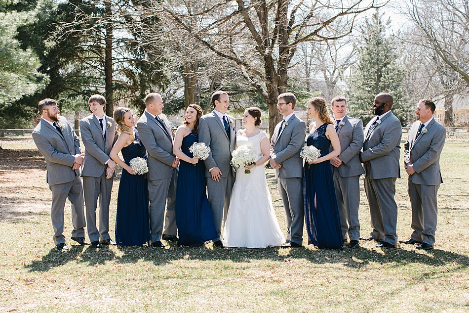 Bridal Party in blue dresses and grey tuxes