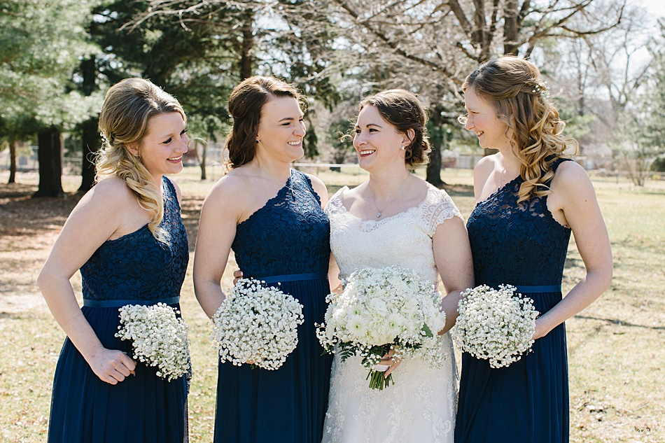Bridesmaids with Baby's Breath bouquets and blue dresses