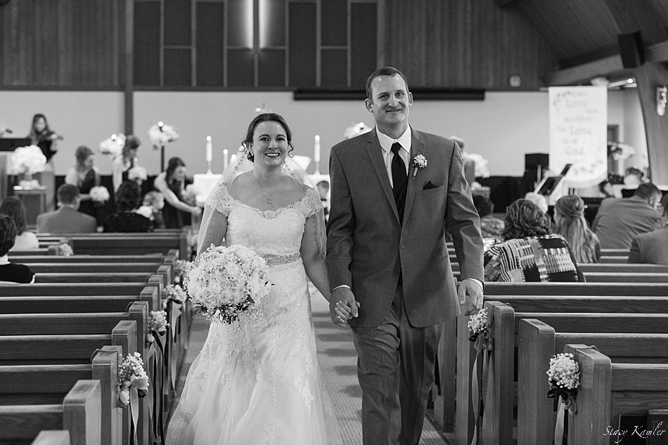 A newly married couple walking down the isle